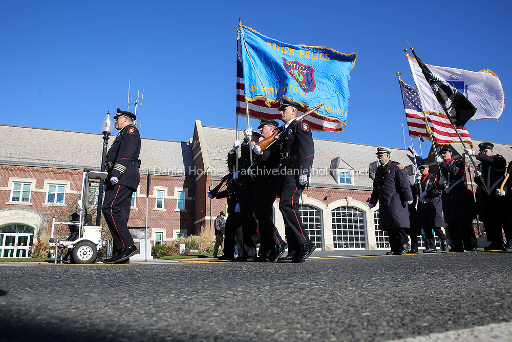 (11/11/17, NATICK, MA) The parade marches down East Central Street during the Veterans Day Parade in Natick on Saturday. [Daily News and Wicked Local Photo/Dan Holmes]