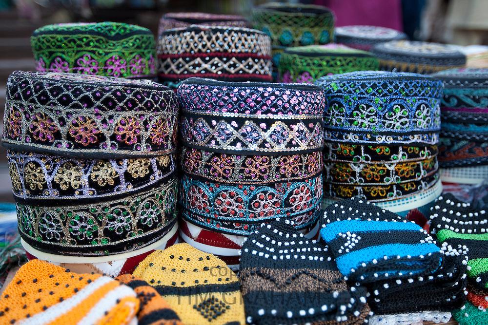 Traditional muslim prayer caps, takiyah, or kufi, on sale at Meena Bazar market in Muslim area of Old Delhi, India