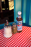 andy spain architectural photography<br /> hp sauce bottle on red and white table cloth london street life