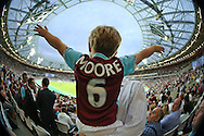 a Young West Ham fan wears his Bobby Moore shirt with pride as he soaks in the atmosphere at the new stadium as the 2nd half kicks off .. UEFA Europa league, 3rd qualifying round match, 2nd leg, West Ham Utd v NK Domzale at the London Stadium, Queen Elizabeth Olympic Park in London on Thursday 4th August 2016.<br /> pic by John Patrick Fletcher, Andrew Orchard sports photography.