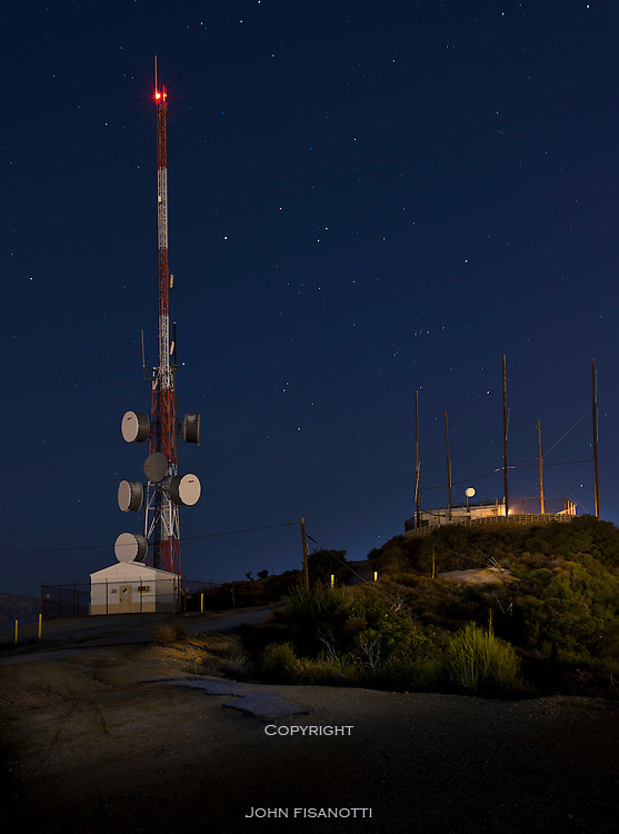 Communication towers at night.