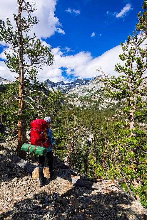 Backpacker on trail in the John Muir Wilderness, Sierra Nevada Mountains, California USA
