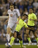 Photo: Olly Greenwood.<br />Tottenham Hotspur v FC Braga. UEFA Cup. 14/03/2007. Spurs Michael Dawson and Braga's Luis Filipe