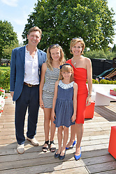 DARCEY BUSSELL and ANGUS FORBES with their children ZOE & PHOEBE at the Audi International Polo at Guards Polo Club, Windsor Great Park, Egham, Surrey on 26th July 2014.
