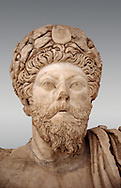 Roman sculpture of the Emperor Marcus Aurelius, excavated from Bulla Regia Theatre, sculpted circa late second century. The Bardo National Museum, Tunis.   Against a grey background. .<br /> <br /> If you prefer to buy from our ALAMY STOCK LIBRARY page at https://www.alamy.com/portfolio/paul-williams-funkystock/greco-roman-sculptures.html . Type -    BARDO    - into LOWER SEARCH WITHIN GALLERY box - Refine search by adding a subject, place, background colour, museum etc.<br /> <br /> Visit our CLASSICAL WORLD HISTORIC SITES PHOTO COLLECTIONS for more photos to download or buy as wall art prints https://funkystock.photoshelter.com/gallery-collection/The-Romans-Art-Artefacts-Antiquities-Historic-Sites-Pictures-Images/C0000r2uLJJo9_s0c
