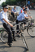 Officials riding bicycles in Gulou area<br /><br />Electric vehicles are everywhere on China's roads, from battery powered pedal bikes to hybrid cars, electric buses and all types of service vehicles.