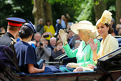 © Licensed to London News Pictures. 08/06/2019. London, UK. Camilla Duchess of Cornwall, Catherine Duchess of Cambridge, Meghan Duchess of Sussex and Prince Harry Duke of Sussex make their way to Horse Guards Parade for the Trooping the Colour ceremony, which marks the 93rd birthday of Queen Elizabeth II, Britain's longest reigning monarch. Photo credit: Dinendra Haria/LNP