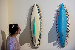 "© Licensed to London News Pictures. 08/10/2020. LONDON, UK. A staff member views ""Sea Green"", 2020, and ""Pale Blue and Pink"", 2019, both by LR Vandy.  Preview of 1-54 Contemporary African Art Fair, the leading international art fair dedicated to contemporary art from Africa and its diaspora, taking place at Somerset House.  The fair showcases the work of more than 110 emerging and established artists from Africa and is the only physical art fair taking place during Frieze Week.  Photo credit: Stephen Chung/LNP"