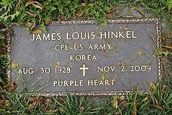 31 August 2017:   Veterans graves in Park Hill Cemetery in eastern McLean County.<br /> <br /> James Louis Hinkel Corporal US Army Korea Aug 30 1928 Nov 2 2009 Purple Heart