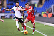 Craig Noone of Cardiff city ® holds off Rotherham's Emmanuel Ledesma. Skybet football league championship match, Cardiff city v Rotherham Utd at the Cardiff city stadium in Cardiff, South Wales on Saturday 6th December 2014<br /> pic by Andrew Orchard, Andrew Orchard sports photography.