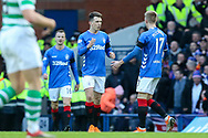 Ryan Jack (#8) of Rangers FC celebrates his goal with Ross McCrorie (#17) of Rangers FC during the Ladbrokes Scottish Premiership match between Rangers and Celtic at Ibrox, Glasgow, Scotland on 29 December 2018.