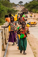 Young girls on the main road who have filled water containers at the Sagan River, near Konso, Southern Nations Nationalities and People's Region, Ethiopia.