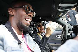 October 22, 2017 - Austin, Texas, U.S. - USAIN BOLT gets a ride around the track with #44 LEWIS HAMILTON (GBR, Mercedes AMG Petronas F1 Team) FIA Formula One World Championship 2017, Grand Prix of United States. (Credit Image: © Hoch Zwei via ZUMA Wire)
