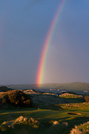 Rainbow over the 18th green/West Course/Saunton Golf Club. <br /> Picture Credit / Phil Inglis..<br /> <br /> Saunton Golf Club is home to two of the great mature links golf courses of the World. The pair of Championship courses is located in the Braunton Burrows of North Devon less than ½ mile from the Atlantic Ocean set in the towering dunes that form the backdrop to their magnificent location. The basis for the present East Course was laid out under the direction of the renowned course architect W. Herbert Fowler in the 1920.s and so began the reputation as one of the finest links courses in the country.