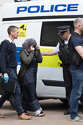 June 4, 2017 - London, London, UK - LONDON, UK.  A covered women is removed by police officers outside the block of flats in Kings Road, Barking that police raided this today in connection with terror attack and four women were removed from the flats by police this lunchtime. (Credit Image: © Vickie Flores/London News Pictures via ZUMA Wire)