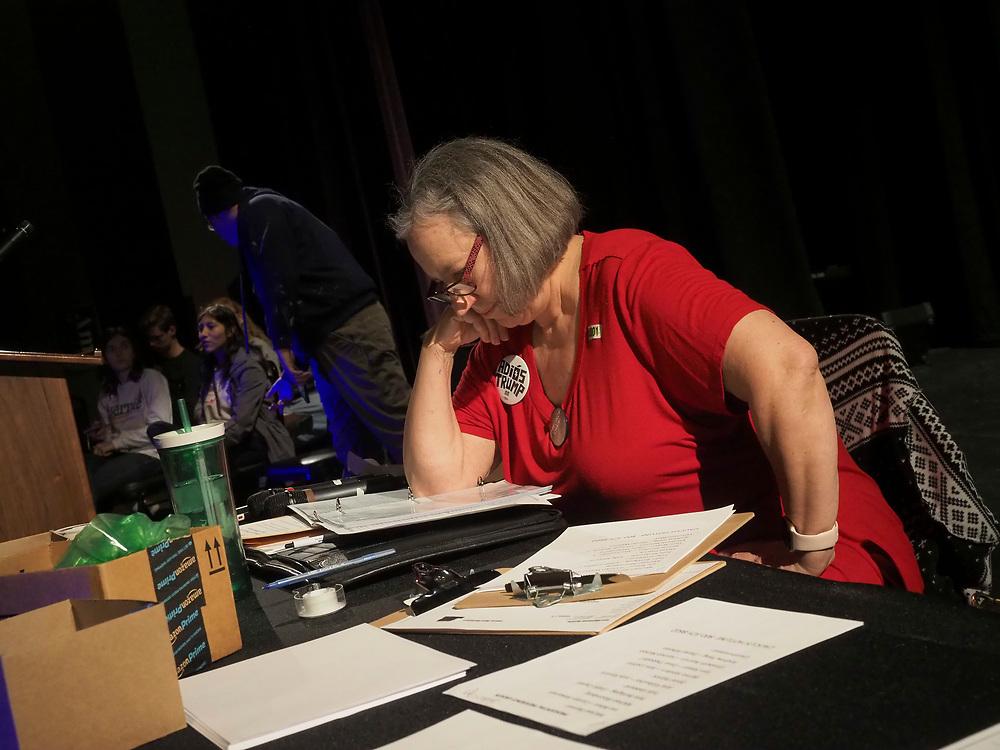 Fairfield Iowa Precinct 4 Caucus Chair Sallee Haerr reviews results of caucus