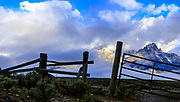 Limited Edition: (limit 30) Bar BC Gate Entrance Silhouette with Teton Mountain Range in the background. Clouds with some blue.