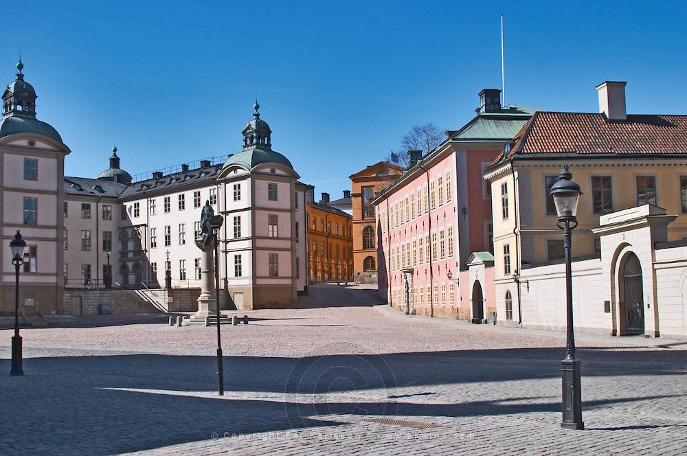 The Wrangelska Palatset on Riddarholmen, seat of Svea Hovratt, the appeals court, dating back to the 16th century. The red pink Stenbockska Palatset on Riddarholmen, seat of the Regeringsrätten court, dating from the 17th century. The yellow Hessensteinska Palatset on Riddarholmen dating from the 17th century. Stockholm. Sweden, Europe.