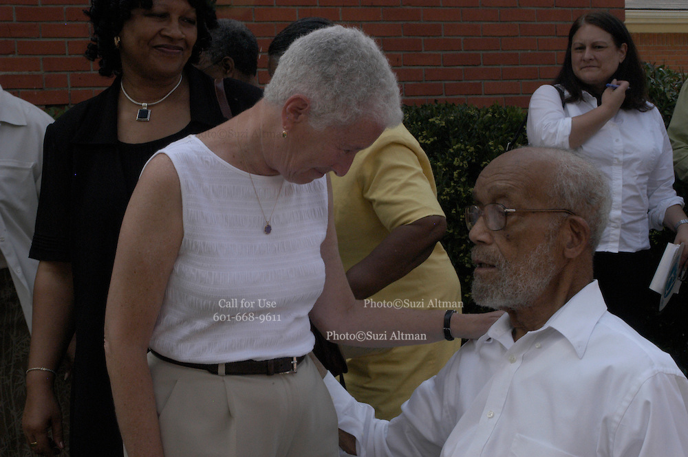 """Rita Schwerner Bender,right,widow  of murdered civil rights worker Michael """"Micky"""" Schwerner, bows her head during the  emotioanl  memorial service at the Mt. Zion U.M. Church in Philadelphia Ms. Sunday June 19,2005. Sitting next to her is Barbara Chaney Dailey, James Chaney's sister she is holding a program from the memorial service with her brothers photo on it."""