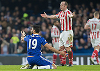Football - 2016 / 2017 Premier League - Chelsea vs. Stoke City <br /> <br /> Diego Costa of Chelsea appeals for the foul while Charlie Adam of Stoke City pleads his innocence at Stamford Bridge.<br /> <br /> COLORSPORT/DANIEL BEARHAM