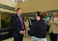 Governor Chris Sununu speaking with Sarah Decormier LRGH Communications following Sununu's bill signing at the Lakes Region General Hospital on Thursday morning.   (Karen Bobotas/for the Laconia Daily Sun)