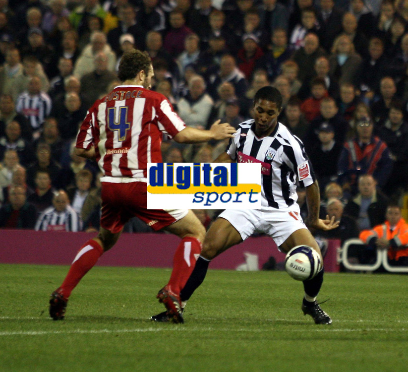 Photo: Mark Stephenson.<br /> West Bromwich Albion v Stoke City. Coca Cola Championship. 03/10/2007.West Brom's Sherjill MacDonald holds the ball up from Stokes  John Eustace