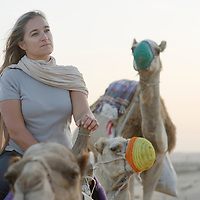 Al-Ain (Abu Dhabi), United Arab Emirates 04 April 2009.A tourist rides a camel in desert of Al Ain..PHOTO: EZEQUIEL SCAGNETTI