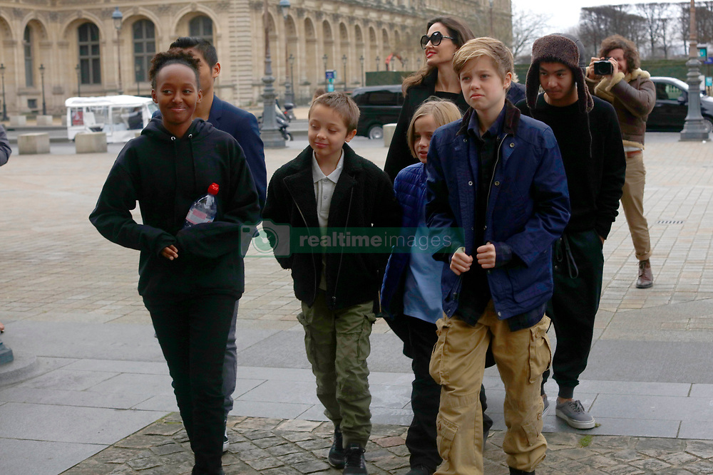 Angelina Jolie with her children Shiloh, Maddox, Vivienne Marcheline, Pax Thien, Zahara Marley, Knox Leon visit The Louvre in Paris. ***SPECIAL INSTRUCTIONS*** Please pixelate children's faces before publication.***. 30 Jan 2018 Pictured: Angelina Jolie, Shiloh, Maddox, Vivienne Marcheline, Pax Thien, Zahara Marley, Knox Leon. Photo credit: MT / MEGA TheMegaAgency.com +1 888 505 6342