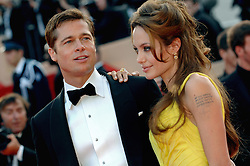 Angelina Jolie and Brad Pitt walk the red carpet of the Palais des Festivals in Cannes, France, May 24, 2007, to attend the gala screening of Steven Soderbergh's film Ocean's Thirteen presented out of competition at the 60th Cannes International Film Festival. After the gang's foray into Europe for 2004's 'Ocean's Twelve', the new flick returns the action to Las Vegas, where Reuben (Elliott Gould) thinks he's getting in on a casino deal with ruthless and sleazy Willy Bank (newcomer Al Pacino). But Bank double-crosses Reuben, giving him a heart attack. Photo by Hahn-Nebinger-Orban/ABACAPRESS.COM