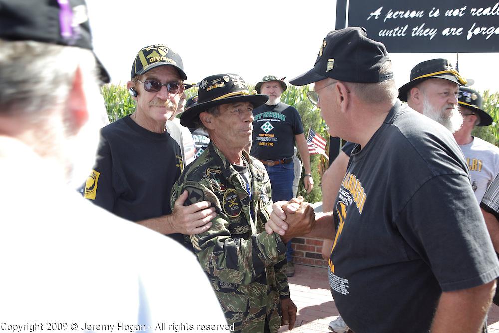 Vietnam Veterans of the 1st Squadron, 9th Cavalry, Burt Martin, left, Jerry Hogan and Floyd Franks greet during the Vietnam Veterans gathering in Kokomo, Indiana for the 2009 reunion.