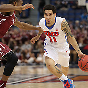Nic Moore, (right), SMU, drives past Will Cummings, Temple, during the Temple Vs SMU Semi Final game at the American Athletic Conference Men's College Basketball Championships 2015 at the XL Center, Hartford, Connecticut, USA. 14th March 2015. Photo Tim Clayton