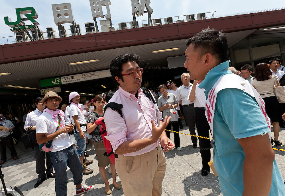 Actor, Taro Yamaoto speaking to a journalist outside Tamachi Station as he campaigns for the House of Councillors election in Tokyo, Japan Friday July 12th 2013 The election will ake place on July 21st. Yamamoto is running as an independent candidate with a strong anti-nuclear power message.