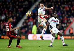 Stoke City's Erik Pieters (centre) and AFC Bournemouth's Jordon Ibe (left) battle for the ball during the Premier League match at the Vitality Stadium, Bournemouth.
