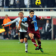 Besiktas's Jose Maria Gutierrez HERNANDEZ (Guti) (L) and Trabzonspor's Ceyhun GULSELAM (R) during their Turkey Cup Group B matchday 5 soccer match Besiktas between Trabzonspor at the Inonu stadium in Istanbul Turkey on Wednesday 26 January 2011. Photo by TURKPIX