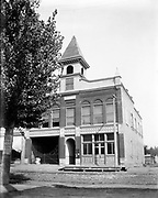 """0405-D04. """"City Hall"""" and Fire House, Newberg, Oregon, ca. 1913. The building looks like it is about to be demolished. Newberg built a new City Hall in 1914."""