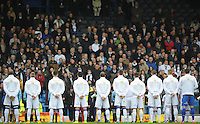 Leeds United players observe a minutes silence ahead of kick-off<br /> <br /> Photographer Kevin Barnes/CameraSport<br /> <br /> Football - The Football League Sky Bet Championship - Leeds United v Blackpool - Saturday 8th November 2014 - Elland Road - Leeds<br /> <br /> © CameraSport - 43 Linden Ave. Countesthorpe. Leicester. England. LE8 5PG - Tel: +44 (0) 116 277 4147 - admin@camerasport.com - www.camerasport.com