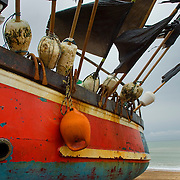 Fishing boat with black flags on the beach, Hastings, East wessex, England