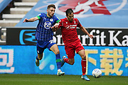Nottingham Forest defender Yuri Ribeiro (2) runs at Wigan Athletic midfielder Joe Williams (20) during the EFL Sky Bet Championship match between Wigan Athletic and Nottingham Forest at the DW Stadium, Wigan, England on 20 October 2019.
