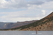 SHOT 6/8/16 7:52:25 AM - Flaming Gorge Reservoir straddles the Utah-Wyoming border and was completed in 1964. The reservoir is mainly in southwest Wyoming and partially in northeastern Utah. The northern tip of the reservoir is 10 miles southeast of Green River, Wyoming, 14 miles southwest of Rock Springs, Wyoming, and 43 miles north of Vernal, Utah. Visitors enjoy world class fishing, hiking, boating, windsurfing, camping, backpacking, cross-country skiing, and snowmobiling within Flaming Gorge National Recreation Area, which is operated by Ashley National Forest. (Photo by Marc Piscotty / © 2016)