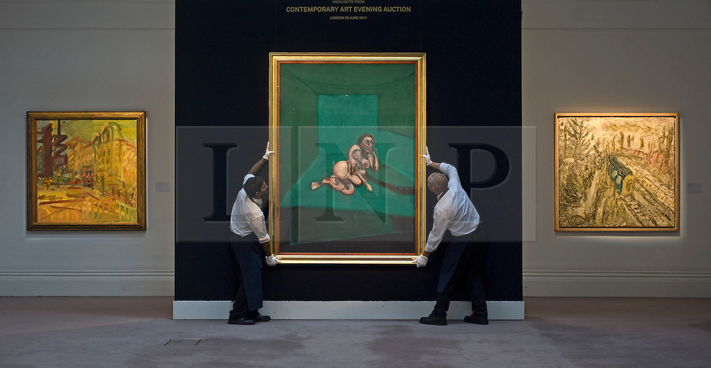 "© licensed to London News Pictures. London, UK  17/06/2011. Sotheby's workers hold ""Crouching Nude' by Francis Bacon (Centre),which is estimated to fetch  up to £9 million at auction as part of Sotheby's upcoming auction of Modern art. Please see special instructions for usage rates. Photo credit should read Ben Cawthra/LNP"