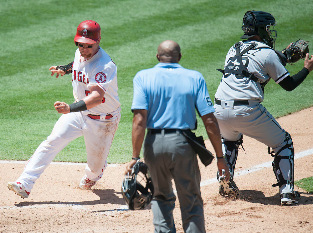 The Angels' Kole Calhoun scores around White Sox catcher Omar Narvaez in the fifth inning at Angel Stadium on Sunday.<br /> <br /> ///ADDITIONAL INFO:   <br /> <br /> angels.0718.kjs  ---  Photo by KEVIN SULLIVAN / Orange County Register  -- 7/17/16<br /> <br /> The Los Angeles Angels take on the Chicago White Sox at Angel Stadium.