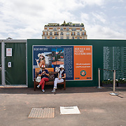 PARIS, FRANCE June 12.  Two ladies enjoy coffee on a park bench in the grounds of Roland Garros during competition at the 2021 French Open Tennis Tournament at Roland Garros on June 12th 2021 in Paris, France. (Photo by Tim Clayton/Corbis via Getty Images)