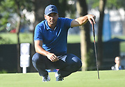 ST. LOUIS, MO - AUGUST 09: Jason Day lines up his putt on the #10 green during the first round of the PGA Championship on August 09, 2018, at Bellerive Country Club, St. Louis, MO.  (Photo by Keith Gillett/Icon Sportswire)