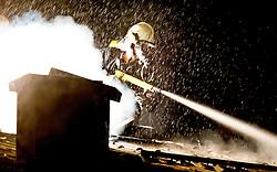 21.02.2011, Häuslhofstrasse, Kaprun, AUT, Feuerwehr bei Brandbekämpfung, im Bild Feature / Themenbild, Feuerwehrmänner in Atemschutzkleidung bei einem Löschvorgang in der Nacht, Bild wurde während eines Löscheinsatzes am 21.02.2011 in Kaprun aufgenommen, EXPA Pictures © 2011, PhotoCredit: EXPA/ J. Feichter