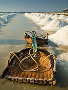10 FEBRUARY 2016 - BAN LAEM, PHETCHABURI, THAILAND:  Baskets used by salt workers in the salt fields. The salt harvest in Thailand usually starts in February and continues through May. Salt is harvested in many of the provinces along the coast, but the salt fields in Phetchaburi province are considered the most productive. The salt fields are flooded with sea water, which evaporates off leaving salt behind. Salt production relies on dry weather and producers are hoping the current drought will mean a longer harvest season for them.     PHOTO BY JACK KURTZ