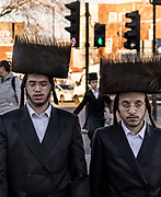 Orthadox Jews heading for prayer during the Purim festival in Stanford Hill on 26th February, 2021 in London, United Kingdom. Purim is a Jewish holiday which commemorates the saving of the Jewish people from Haman, an Achaemenid Persian Empire official who was planning to kill all the Jews.A shtreimel is a fur hat worn by some Jewish men, mainly members of Hasidic Judaism, on Shabbat and Jewish holidays and other festive occasions. Men are encouraged to drink wine or any other alcoholic beverage.