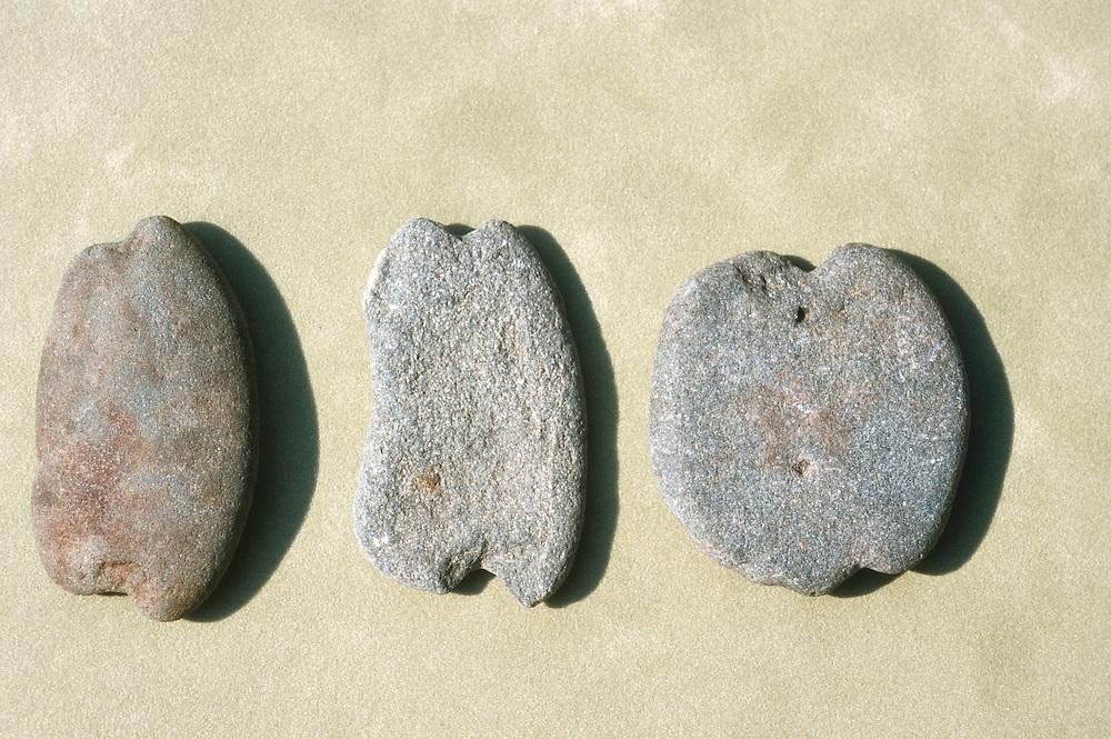 Alaska. Kachemak Bay. Historical artifacts. Old native stone fishing weights found in Bay.