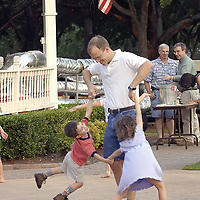 Having a swinging time Eric Cassidy swing dances with his children Colby, 3, and Cassidy, 5, during the Concert in the Park celebration in Friendswood, 05/27/05.  <br />   (Photo by Kim Christensen)