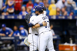 August 22, 2017 - St. Petersburg, Florida, U.S. - WILL VRAGOVIC   |   Times.Tampa Bay Rays relief pitcher Alex Colome (37) hugs catcher Wilson Ramos (40) after the game between the Toronto Blue Jays and the Tampa Bay Rays at Tropicana Field in St. Petersburg, Fla. on Tuesday, Aug. 22, 2017. The Tampa Bay Rays beat the Toronto Blue Jays 6-5. (Credit Image: © Will Vragovic/Tampa Bay Times via ZUMA Wire)