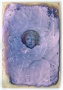 glass plate with child portrait  and retouching paint France ca 1910s
